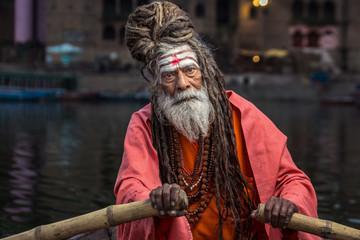 Portrait of sadhu rowing the boat, Varanasi, India.