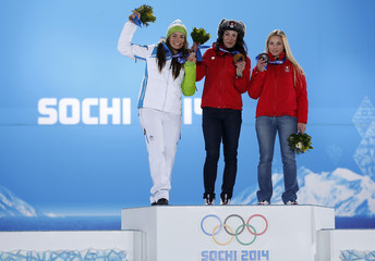 Medalists pose on the podium during the medal ceremony for the women's alpine skiing downhill race at the Sochi 2014 Winter Olympic Games in Sochi