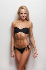 young beautiful woman black bikini