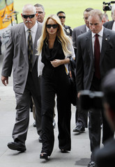 Actress Lindsay Lohan returns from a lunch break to the Beverly Hills Municipal Courthouse