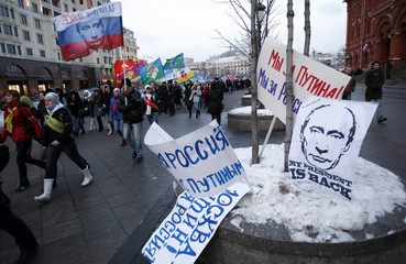 Participants gather during a rally in support of Russian PM Putin held close to Moscow 's Kremlin