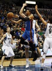Oklahoma City's Westbrook drives past Minnesota Timberwolves' Pekovic during their NBA basketball game in Minneapolis