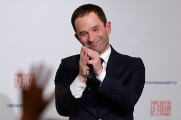 Former French education minister Benoit Hamon reacts after partial results in the second round of the French left's presidential primary election in Paris