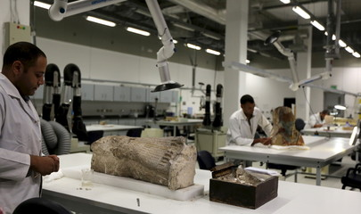 Archaeologists renovate artifacts at the Grand Egyptian Museum in Giza