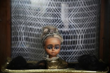 A head of a mannequin decorates a hair salon in Rabat's Medina