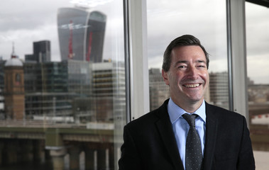 Financial Times CEO John Ridding poses for a photo at the Financial Times headquarters in London