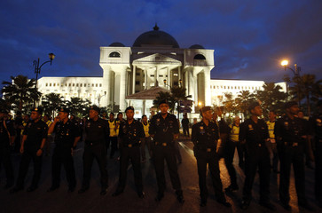 Police officers stand guard at the entrance to the courthouse ahead of the verdict announcement in the sodomy trial of Malaysia's opposition leader Anwar Ibrahim in Kuala Lumpur