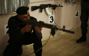 A member of Palestinian security forces loyal to Hamas aims a weapon during a training session which involves using laser to shoot at electronic targets, in Gaza City