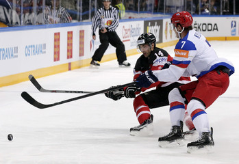 Russia's Kulikov challenges Canada's Eberle during their Ice Hockey World Championship final game at the O2 arena in Prague