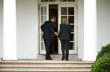 U.S. President Barack Obama walks with Elizabeth Sherwood-Randall, director for European affairs at the National Security Council, at the White House