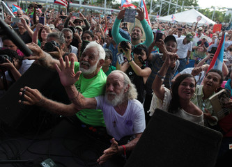 Supporters cheer during a rally in honour of Puerto Rican Oscar Lopez Rivera (not pictured) after he was released from house arrest in San Juan