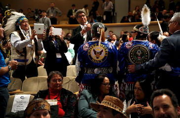 Attendees take pictures as they wait for Obama to arrive to deliver remarks at the annual White House Tribal Nations Conference in Washington