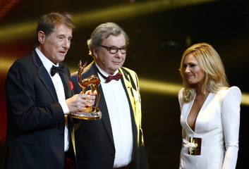 Critic Karasek and singer Fischer present Juergens with trophy for Lifetime Achievement during Bambi 2013 media awards ceremony in Berlin