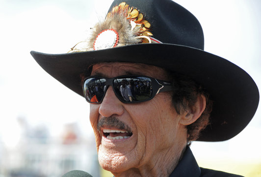 Racing legend Petty speaks after a dedication ceremony for the new Muscle Cars Forever stamps at the Daytona International Speedway
