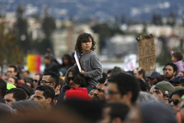 A child looks on during a demonstration against police violence in Oakland, California