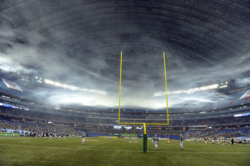 The Toronto Argonauts play the Winnipeg Blue Bombers under a cloud of smoke during their CFL football game in Toronto