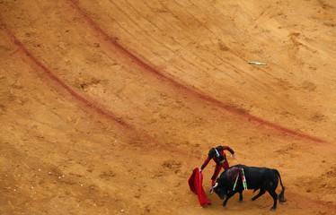 Spanish matador Morante de la Puebla performs a pass to a bull during a bullfight in The Maestranza bullring in Seville