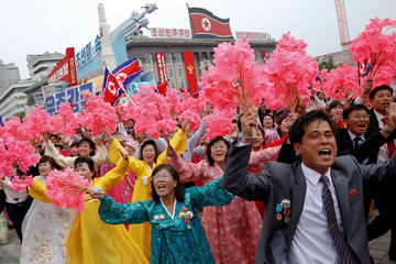 People react as they see North Korean leader Kim Jong Un during a mass rally and parade in the capital's main ceremonial square, a day after the ruling party wrapped up its first congress in 36 years by elevating him to party chairman, in Pyongyang