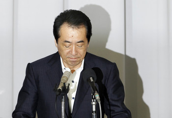 Japan's Prime Minister Naoto Kan attends a general meeting of his DPJ lawmakers in Tokyo