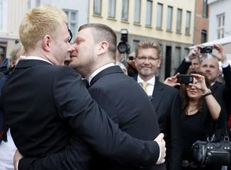 Gay couple Schmitt and Nicolai exchange kisses after being married by Copenhagen's Mayor Frank Jensen in Copenhagen