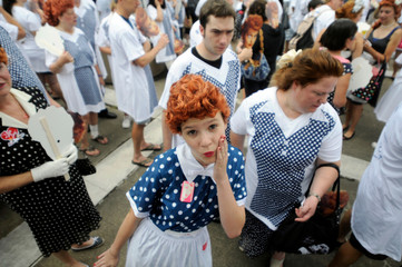 Girl takes part in an attempt to set a new Guinness world record for most Lucy Ricardo lookalikes assembled in one place, in Jamestown