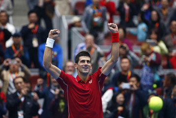 Djokovic of Serbia celebrates after winning against Murray of Britain during their men's singles semi-final match at the China Open tennis tournament in Beijing