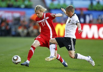 Germany's Schweinsteiger fights for the ball with Serbia's Krasic during a 2010 World Cup Group D soccer match in Port Elizabeth