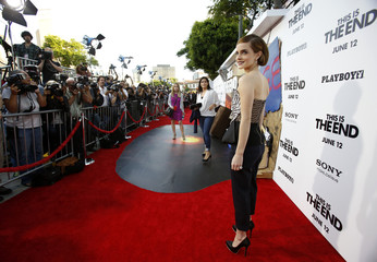 """Cast member Emma Watson poses at the premiere of """"This Is the End"""" in Los Angeles"""