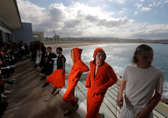 Models for the Ten Pieces collection pose on the Balcony of Bondi Icebergs following a runway show at Fashion Week Australia in Sydney