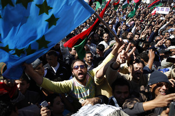 Demonstrator holds European Union flag as thanks for participating in coalition attacks against forces loyal to Libyan leader Gaddafi, in Benghazi