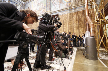 Media films the stove at the Sistine Chapel in the Vatican