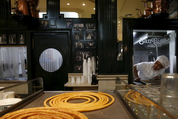 File photo of cook Christian Santana checking to see if more churros are needed during breakfast time at the Chocolate Shop San Gines in Madrid