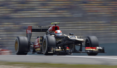 Lotus Formula One driver Romain Grosjean of France drives during the third practice session of the Chinese F1 Grand Prix at the Shanghai International Circuit