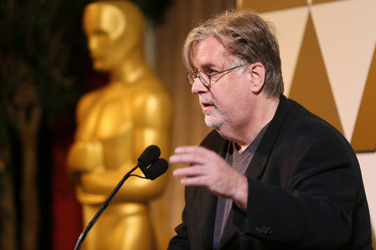 Cartoonist Groening presents director Vinterberg with a nomination certificate at the 86th Academy Awards Foreign Language Nominee Reception at Ray's and Stark Bar on the LACMA Campus in Los Angeles