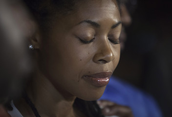 Amy, sister of Miriam Carey, the woman involved in the Capitol Hill shooting, attends a news conference outside their home in the Brooklyn borough of New York
