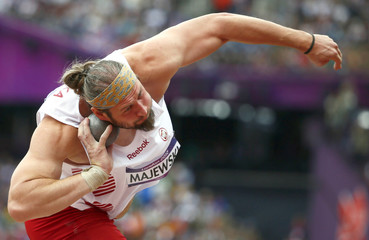 Poland's Tomasz Majewski competes in the men's shot put qualification at London 2012 Olympic Games