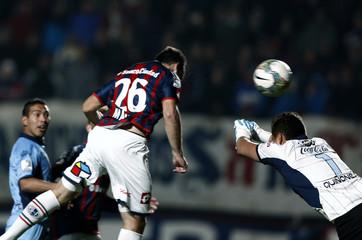 Matos of San Lorenzo heads the ball against Bolivar during their Copa Libertadores semi-final soccer match in Buenos Aires