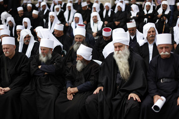 Druze men gather to mark Syria's independence from France in 1946 at the village of Majdel Shams in Golan Heights, on the Israeli side of the ceasefire line between Syria and Israel