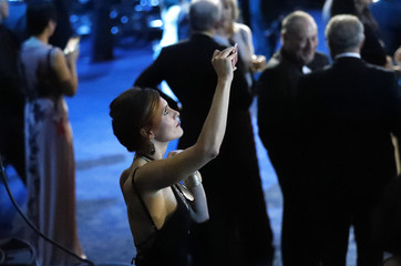 "A guest takes a picture at the ""Liberty"" inaugural ball for U.S. President Donald Trump and his wife Melania in Washington"