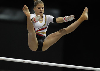 Germany's Seitz grimaces as she competes on the uneven bar at the qualifying round of the Gymnastics World Championships at the Ahoy Arena in Rotterdam