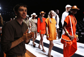 Lacoste designer Christopher Lemaire gestures before presenting a creation at the Lacoste Spring 2011 collection during New York Fashion Week