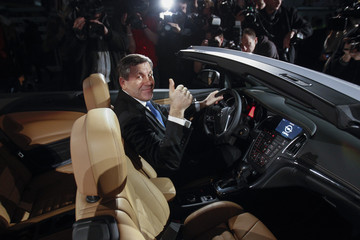 Poland's Deputy Prime Minister Piechocinski gestures as he poses for a picture in an Opel Cascada at Opel Gliwice factory in southern Poland