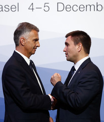 Swiss President and President of the Organization for Security and Co-operation in Europe Burkhalter welcomes Ukraine's FM Klimkin at the meeting of foreign ministers from the OSCE in Basel