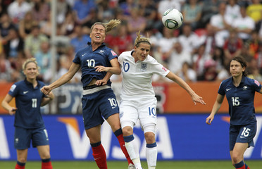 Smith of England challenges Abily of France during their Women's World Cup quarterfinal soccer match in Leverkusen
