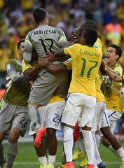 Brazil's goalkeeper Cesar celebrates with his teammates during the penalty shootout with Chile in their 2014 World Cup round of 16 game at the Mineirao stadium in Belo Horizonte