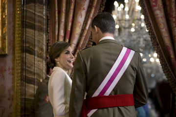 Spain's King Felipe VI and his wife Queen Letizia talk during the Epiphany Day celebrations at the Royal Palace in Madrid