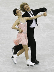 Davis and White of the U.S. perform during the ice dance short dance at the ISU Grand Prix of Figure Skating Final in Fukuoka