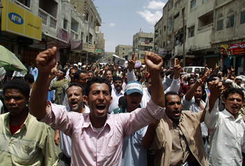 Anti-government protesters shout slogans as they march during a demonstration to demand the ouster of Yemen's President Ali Abdullah Salehin the southern city of Taiz
