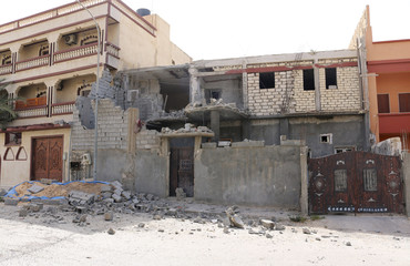 Damage to a house is seen following clashes between rival militias in the Janzour district on the outskirts of Tripoli.