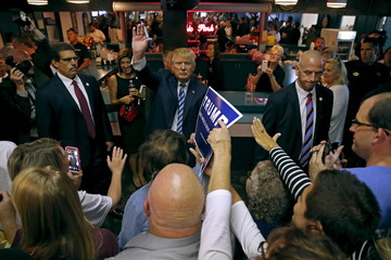 U.S. Republican presidential candidate Donald Trump waves to supporters at a campaign event in Waterloo